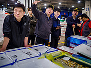 09 OCTOBER 2018 - SEOUL, SOUTH KOREA: An auctioneer during a fish auction in the Noryangjin Fish Market. The auctions start about 01.00 AM and last until 05.00 AM. Noryangjin Fish Market is the largest fish market in Seoul and has been in operation since 1927. It opened in the current location in 1971 and was renovated in 2015. The market serves both retail and wholesale customers and has become a tourist attraction in recent years.           PHOTO BY JACK KURTZ
