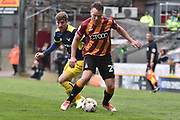 Bradford City Defender, Anthony McMahon (29) and Oxford United Forward, Conor McAleny (11)  during the EFL Sky Bet League 1 match between Bradford City and Oxford United at the Coral Windows Stadium, Bradford, England on 14 April 2017. Photo by Mark Pollitt.