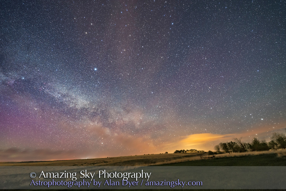 Scorpius rising at far right, and the summer Milky Way and Summer Triangle stars rising at left, in a veyr wide-angle but single shot on May 15, 2017, showing the northern spring sky. Shot from home in southern Alberta, at a latitude of 51&deg; North. Light pollution and aurora adds colour to the sky. <br /> <br /> Shot with a Rokinon 14mm SP lens at f/2.5 and Canon 6D. For a stack of 4 x one minute exposures tracked on the Sky-Watcher Star Adventurer Mini. The ground comes from one tracked exposure.