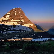 Monolithic Bearhat Mountain reflecting in Hidden Lake at sunrise in Glacier National Park, MT.