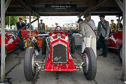 © Licensed to London News Pictures. <br /> 13/09/2019. . <br /> Goodwood.West, Sussex. UK.<br /> The Goodwood Motor Circuit celebrates the 21st year of the Revival.This has become one of the biggest annual historic motorsport events in the world and the only one to be staged entirely in period dress. Each year over 150,000 people descend on this quiet corner of West Sussex to enjoy the three-day event.<br /> Pictured A photographer take images of classic Alpha Romeo.<br /> <br /> Photo credit: Ian Whittaker/LNP