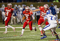 Quarterback Matt Swormstedt, runningback Kyle Chiasson and linebacker Keith Schultz during a play against Manchester West on Friday night's Homecoming game under the lights on Fitzgerald Field.