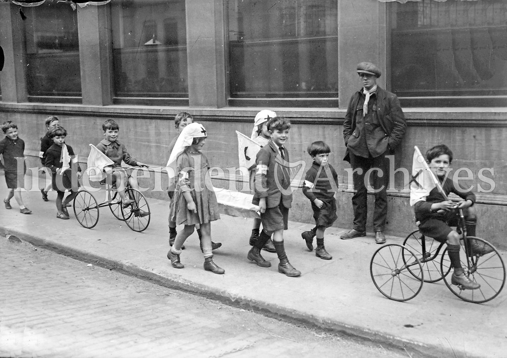 Children at play in Dublin, 1922; the children in the image are dressed up as members of the Red Cross. (Part of the Independent Newspapers Ireland/NLI Collection)