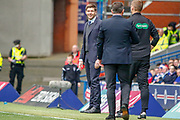 Rangers Manager Steven Gerrard  smiles at the 4th official during the Ladbrokes Scottish Premiership match between Rangers and Aberdeen at Ibrox, Glasgow, Scotland on 27 April 2019.
