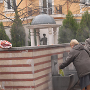 Early morning in Sofia, locals collecting free mineral water in the drinking fountain complex center behind the Mineral Baths in central Sofia.