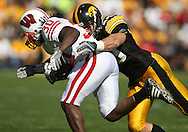 18 OCTOBER 2008: Wisconsin running back Zach Brown (30) is hit by Iowa linebacker A.J. Edds (49) in the first half of an NCAA college football game against Wisconsin, at Kinnick Stadium in Iowa City, Iowa on Saturday Oct. 18, 2008. Iowa won 38-16.