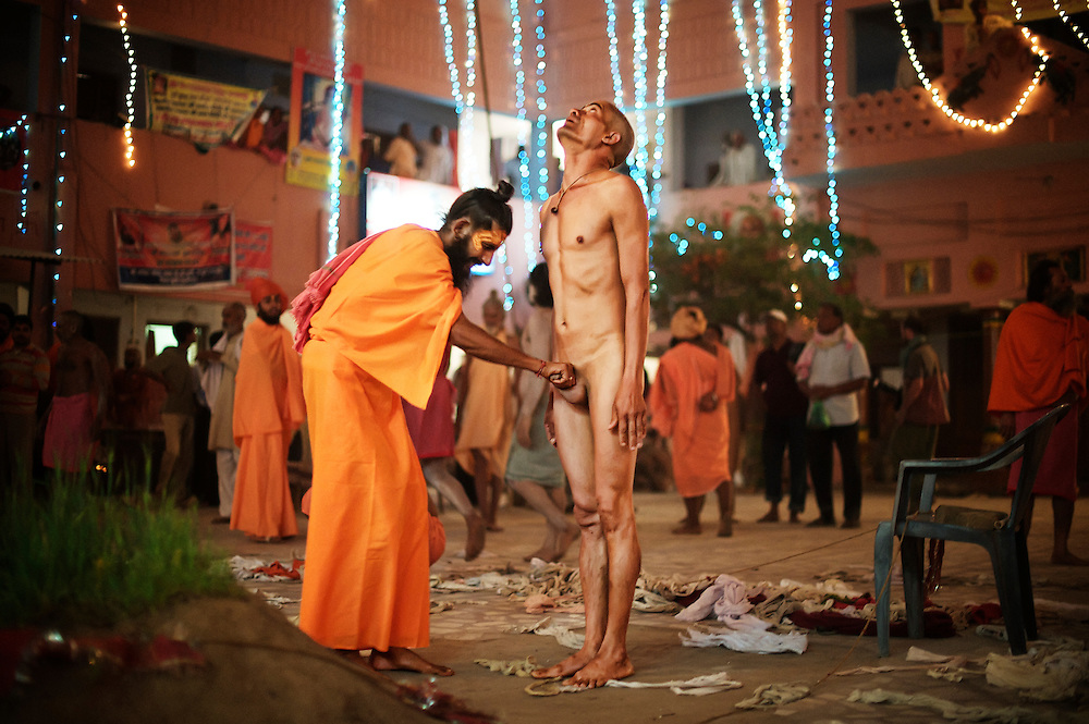 A senior Naga Sadhu pulling the p***s of a newly initiated Naga, they pull it so hard that it becomes unusable again. It is a part of the process of their initiation as Naga and it falls in the last phase of the process...Kumbh Mela, 2010, Haridwar, Uttarakhand.