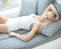 High angle view of woman sleeping on sofa at home