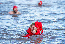 © Licensed to London News Pictures. 14/12/2019. Clevedon, North Somerset, UK. LINDSEY COLE dressed as a lobster swims as part of the Icebreaker challenge to raise money for homeless charity Crisis holding its first Icebreaker Challenge in the Bristol area, with fundraisers in fancy dress swimming in the cold waters of Clevedon's Marine Lake. The event was opened by adventurer and outdoor swimmer Lindsey Cole, who this December is walking along the south coast path to Bristol, encouraging others to join her swimming in the sea for the homeless. Crisis is a national charity for homeless people which helps people directly out of homelessness and campaigns for the social changes needed to solve it altogether. Crisis provides services across Britain with help for people experiencing homelessness all year round. Photo credit: Simon Chapman/LNP.