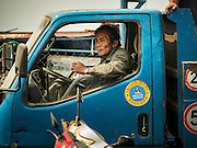 11 MARCH 2016 - LUANG PRABANG, LAOS:   A truck driver on a ferry across the Mekong River near Luang Prabang. Laos is one of the poorest countries in Southeast Asia. Tourism and hydroelectric dams along the rivers that run through the country are driving the legal economy.     PHOTO BY JACK KURTZ