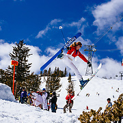 Skiers throw airs off a jump at the Gaper Day gathering at Jackson Hole Mountain Resort.