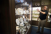 Andrew Pickard Morgan, CEO of Pickard China shows off the official White House fine china in Antioch Thursday morning. Pickard China recently made a full set of china for the White House which was used during the recent state dinner with Japanese leaders. The 320 person set included 12 total pieces each. The cost was $362,000.<br />