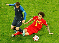 SAINT PETERSBURG, RUSSIA - JULY 10: Antoine Griezmann (L) of France national team and Axel Witsel of Belgium national team vie for the ball during the 2018 FIFA World Cup Russia Semi Final match between France and Belgium at Saint Petersburg Stadium on July 10, 2018 in Saint Petersburg, Russia. MB Media