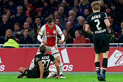 Nicolas Tagliafico #31 of Ajax and Ramon Leeuwin #27 of AZ Alkmaar in action during the Dutch Eredivisie match round 25 between Ajax Amsterdam and AZ Alkmaar at the Johan Cruijff Arena on March 01, 2020 in Amsterdam, Netherlands