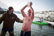 Nathan Nelson pours a gallon of warm water over his head after finishing the New Year's Day Open Water Race at the Great Salt Lake Marina, Tuesday, Jan. 1, 2013. The members of the Wasatch Front Polar Bear Club have been training throughout the winter to prepare them for the 400 meter race through frigid water.