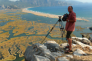 High up on a mountain, within huge remote olive orchards the German wildlife photographer Solvin Zankl found the best view over the Dalyan Delta, where the river artfully creates patterns of water and reed before reaching the beachfront to the open Mediterranean Sea. In the salt water and in the brackish water one can find loggerhead sea turtles (Caretta caretta) and Nile soft-shelled turtles (Trionyx triunguis), respectively, and both species nest in the sand of the long beach.