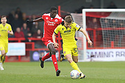 Panutche Camara and George Lloyd during the EFL Sky Bet League 2 match between Crawley Town and Cheltenham Town at the Checkatrade.com Stadium, Crawley, England on 24 March 2018. Picture by Antony Thompson.