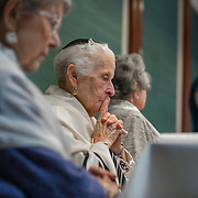 CHEVY CHASE, MD -MAY14: (L-R) Charlotte Gottlieb, 93, Charlotte Markowitz, 85, and Sy Laufe, 90, listen to Cantor Susan Berskson as she makes a speech about their Bat-Mitzvah ceremony at the Five Star Residences in Chevy Chase, Maryland, May 14, 2016. The women who were unable to have a Bat-Mitzvah ceremony at the traditional age of 13 because they were girls, are now finally able to celebrate this traditional Jewish coming of age ceremony. (Photo by Evelyn Hockstein/For The Washington Post)