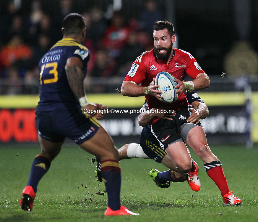 Ryan Crotty of the Crusaders runs into the defence of Malakai Fekitoa of the Highlanders during the Investec Super Rugby game between Crusaders v Highlanders at AMI Stadium, Christchurch. 12 July 2014 Photo: Joseph Johnson/www.photosport.co.nz