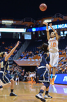 Mar 23, 2013; Knoxville, TN, USA; Tennessee Lady Volunteers guard Meighan Simmons (10) shoots a three pointer against Oral Roberts Golden Eagles forward Taylor Cooper (3) in the first half during the first round of the 2013 NCAA womens tournament at Thompson Boling Arena. Mandatory Credit: Randy Sartin-USA TODAY Sports