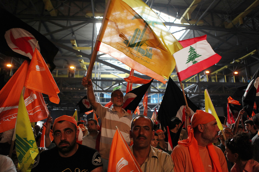 Former Lebanese General Michel Aoun's Free Patriotic Movement held a rally in Beirut just eight days before parliamentary elections. The 7 June elections are expected to be highly contested, with the governing pro-American March 14 coalition facing pressure from the Hizballah-led March 8 opposition, which Aoun's Free Patriotic Movement is a member of. The rally focused on Lebanon's Metn district just north of Beirut. Metn is expected to be one of the closest races between the Christian parties of both coalitions, as well as independent candidates. ///Supporters of Michel Aoun's Free Patriotic Movement dressed in the party's trademark orange color cheer and wave party flags, as well as Lebanese and other flags belonging to the various groups in the March 8 coalition, including Hizballah.