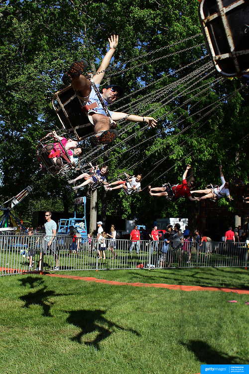 Children enjoy fun rides during the May Fair at Saint Mark's Church, New Canaan, Connecticut, USA. 12th May 2012. Photo Tim Clayton