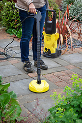 Pressure washer with patio cleaner attachment