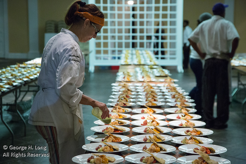 Chef Susan Spicer prepares the plates at Magic in the Moonlight 2015 benefit for the New Orleans Botanical Garden in City Park