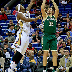 Nov 1, 2016; New Orleans, LA, USA; Milwaukee Bucks forward Mirza Teletovic (35) shoots over New Orleans Pelicans forward Dante Cunningham (33) during the first quarter of a game at the Smoothie King Center. Mandatory Credit: Derick E. Hingle-USA TODAY Sports