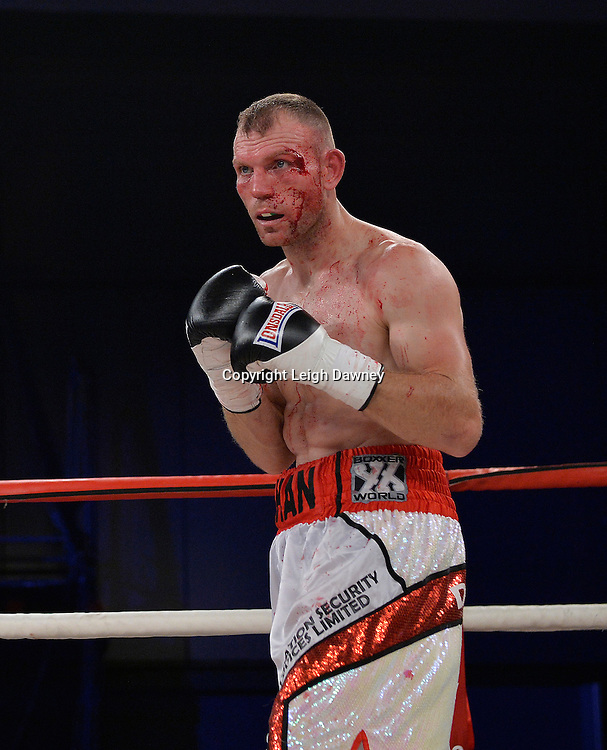 Nathan King with bad cut to the side of the left eye in a middleweight boxing contest against Nick Blackwell at Glow, Bluewater, Kent on the 8th November 2014. Promoter: Hennessy Sports. © Leigh Dawney Photography 2014.
