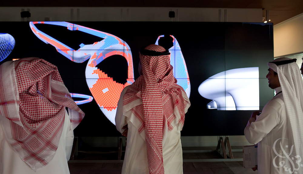 Invited members of the media watch a demonstration of the visualization center during a tour of the King Abdullah University of Science and Technology (KAUST)  September 21, 2009 (about 80 kilometers north of Jeddah.) The University's advanced visualization center gives students and faculty a host of new and innovative methods of interacting with data. Handout photo by Scott Nelson