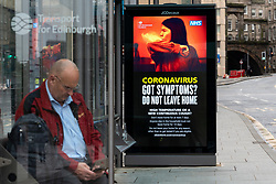 Edinburgh, Scotland, UK. 4 June 2020.  As Covid-19 lockdown relaxation continues in Scotland very few shops and businesses are open. Streets remain quiet and pubs and, with a few exceptions, bars and pubs are closed. Pictured; Coronavirus warning messages at bus stop. Iain Masterton/Alamy Live News