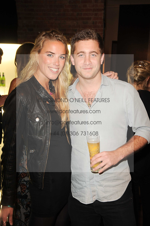 ALEXANDRA WEAVER and TYRONE WOOD son of Ronnie Wood at the Launch of Peroni Nastro Azzurro Accademia del Film Wrap Party Tour held atThe Boiler House, 152 Brick Lane, London E1 on 25th August 2010.