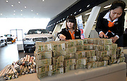 HANDAN, CHINA - MARCH 12: (CHINA OUT) <br /> <br /> Chinese Man Buys Car With Small Change<br /> <br /> Employees deal with small change at an Audi dealership on March 12, 2014 in Handan, Hebei Province of China. Mr.s Li, a wholesale vendor, brought lots of small charge, including 103,000 one-yuan bank notes and 16,300 one-yuan coins, to the dealership to buy a car. <br /> ©Exclusivepix