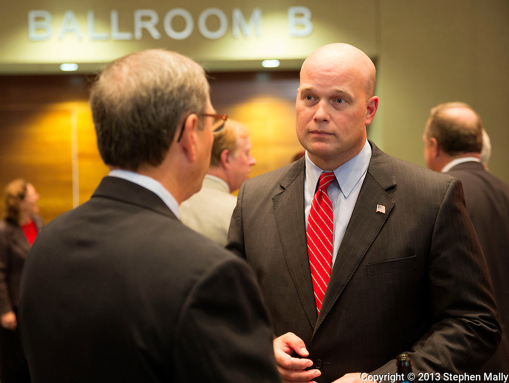 DES MOINES, IA - OCTOBER 25, 2013: Matt Whitaker, candidate for Senate, talks with people before the start of the Iowa GOP Ronald Reagan Dinner at the Iowa Events Center - Community Choice Credit Union Convention Center in Des Moines, Iowa.