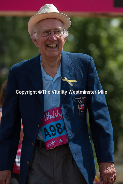 Competitors in the Olympian Wave at the finishing line outside Buckingham Palace at The Vitality Westminster Mile, Sunday 28th May 2017.<br /> <br /> Photo: Thomas Lovelock for The Vitality Westminster Mile<br /> <br /> For further information: media@londonmarathonevents.co.uk