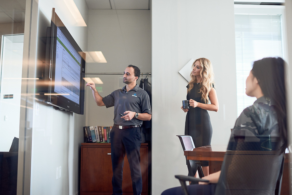 Employees of Quorum and Whitlock use the Microsoft Surface Hub for video conferencing and presentations in at Quorum's offices in Houston, TX on Wednesday January 11, 2107.<br /> <br /> Nathan Lindstrom Photography<br /> ©2017 Nathan Lindstrom