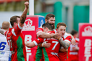 Keighley Cougars scrum half Matty Beharrell (7) scores a try  and celebrates with his team mates during the Betfred League 1 match between Keighley Cougars and Workington Town at Cougar Park, Keighley, United Kingdom on 18 February 2018. Picture by Simon Davies.