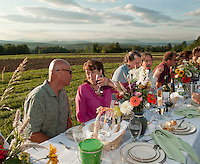 "Bruce and Kikki Gokey toast to a perfect summer night at the Beans and Greens ""Farm to Table Dinner in the Field"" on Wednesday evening.  (Karen Bobotas/for the Laconia Daily Sun)"