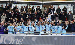 LONDON, ENGLAND - Sunday, February 28, 2016: Manchester City's captain Vincent Kompany lifts the Cup after beating Liverpool on penalties during the Football League Cup Final match at Wembley Stadium. (Pic by Vicky Haydn/Pool/Propaganda)