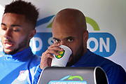 Ipswich Town striker David McGoldrick (10) on the subs bench drinking from a Norwich City cup before the EFL Sky Bet Championship match between Norwich City and Ipswich Town at Carrow Road, Norwich, England on 18 February 2018. Picture by Nigel Cole.