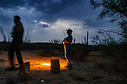 15 JULY 2003 - SELLS, AZ: Tohono O'odham reservation police officers process the scene of the death of an undocumented immigrant in the desert west of Sells, the capitol of the Tohono O'odham reservation, southwest of Tucson, AZ. Six immigrants were found dead in the desert in one day.    PHOTO BY JACK KURTZ