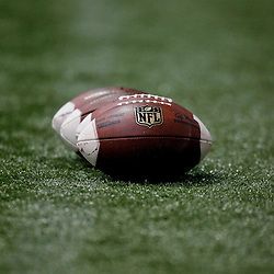 July 27, 2012; Metairie, LA, USA; A detailed view of NFL footballs on the field during training camp at the team's indoor practice facility. Mandatory Credit: Derick E. Hingle-US PRESSWIRE
