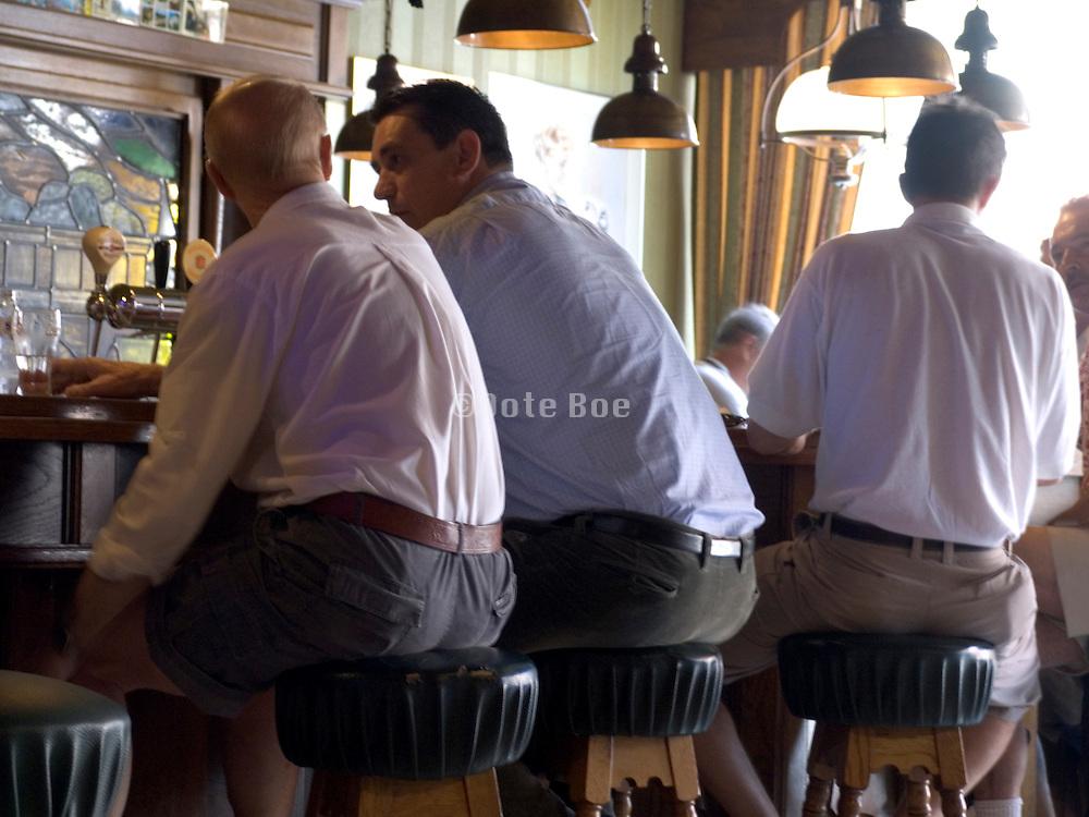men relaxing in a bar Belgium