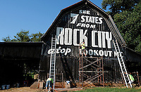 A team from H&M Painting set up to help restore the See Rock City sign on the side of a barn at Cross Creek farms on Calderwood Highway Tuesday morning.Joy Kimbrough | The Daily Times