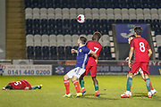 Andrew Winter (Hamilton Academical) & Gerson challenge for the ball while Rafael Brito lies on the ground during the U17 European Championships match between Portugal and Scotland at Simple Digital Arena, Paisley, Scotland on 20 March 2019.