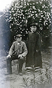 senior man with a priest 1920s