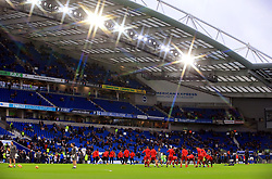 Liverpool's players warm up before the match at the AMEX Stadium