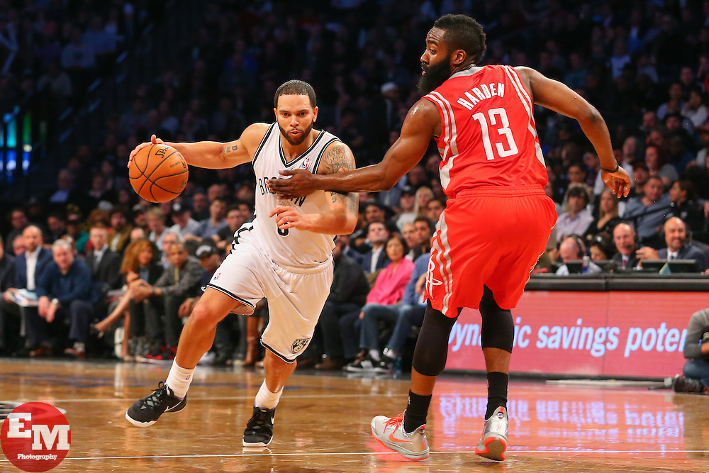 Apr 1, 2014; Brooklyn, NY, USA; Brooklyn Nets guard Deron Williams (8) dribbles the ball past Houston Rockets guard James Harden (13) during the third quarter at Barclays Center. The Nets defeated the Rockets 105-96.
