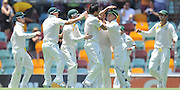 "Australia celebrate the wicket of Jonathon Trott caught behind off the bowling of Mitchell Johnson before lunch on Day 2 of the 1st Test in the 2013-14 Ashes Cricket Series between Australia and England at the GABBA (Brisbane, Australia) from Thursday 21st November 2013<br /> <br /> Conditions of Use : NO AGENTS ~ This image is subject to copyright and use conditions stipulated by Cricket Australia.  This image is intended for Editorial use only (news or commentary, print or electronic) - Required Image Credit : ""Steven Hight - AURA Images"""